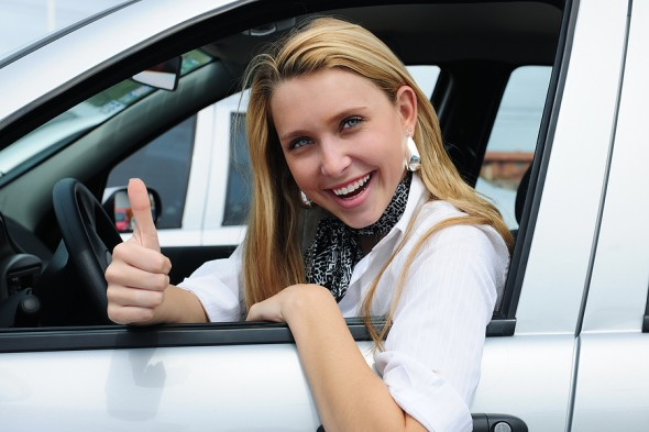 happy woman driving a car